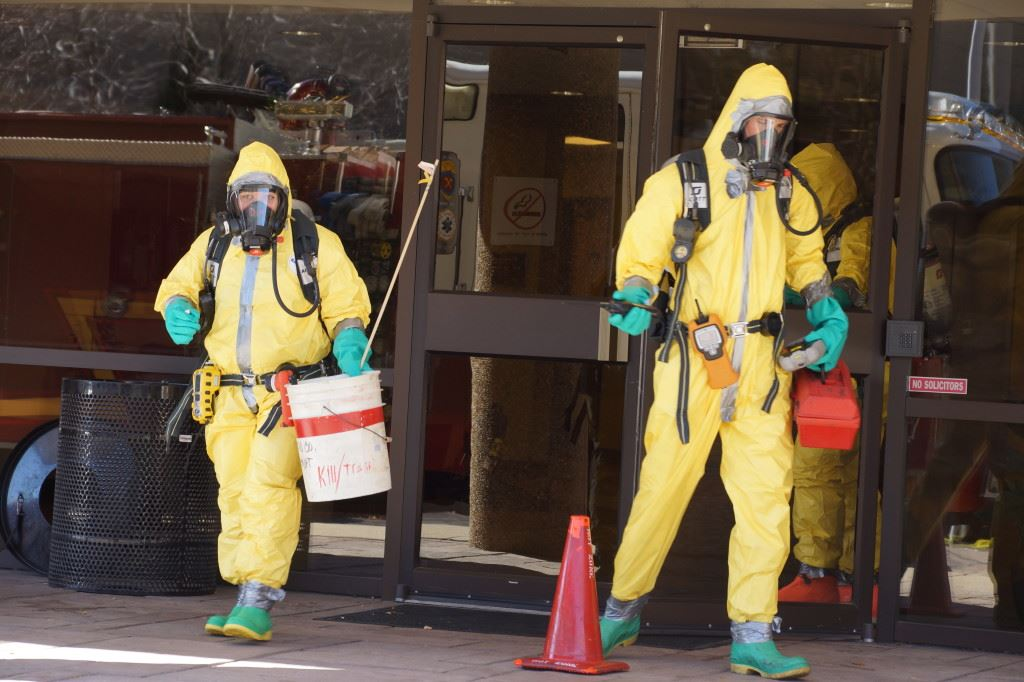 People in Hazard Suits