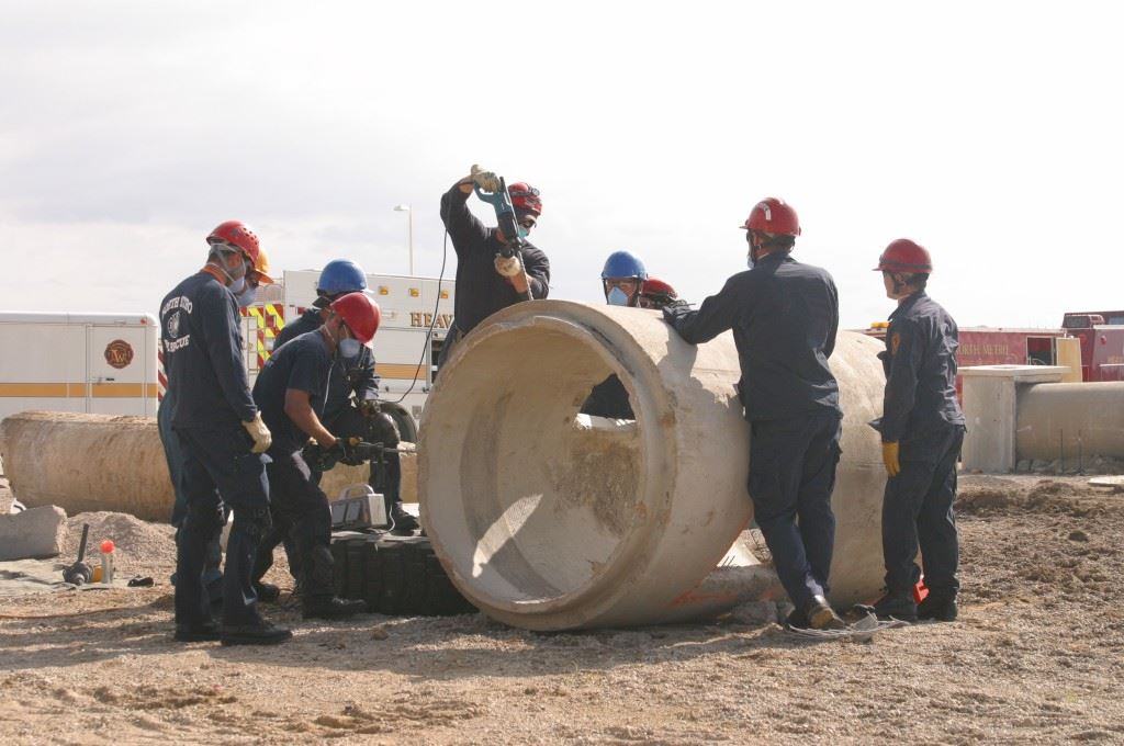 People Working on Cement Cylinder