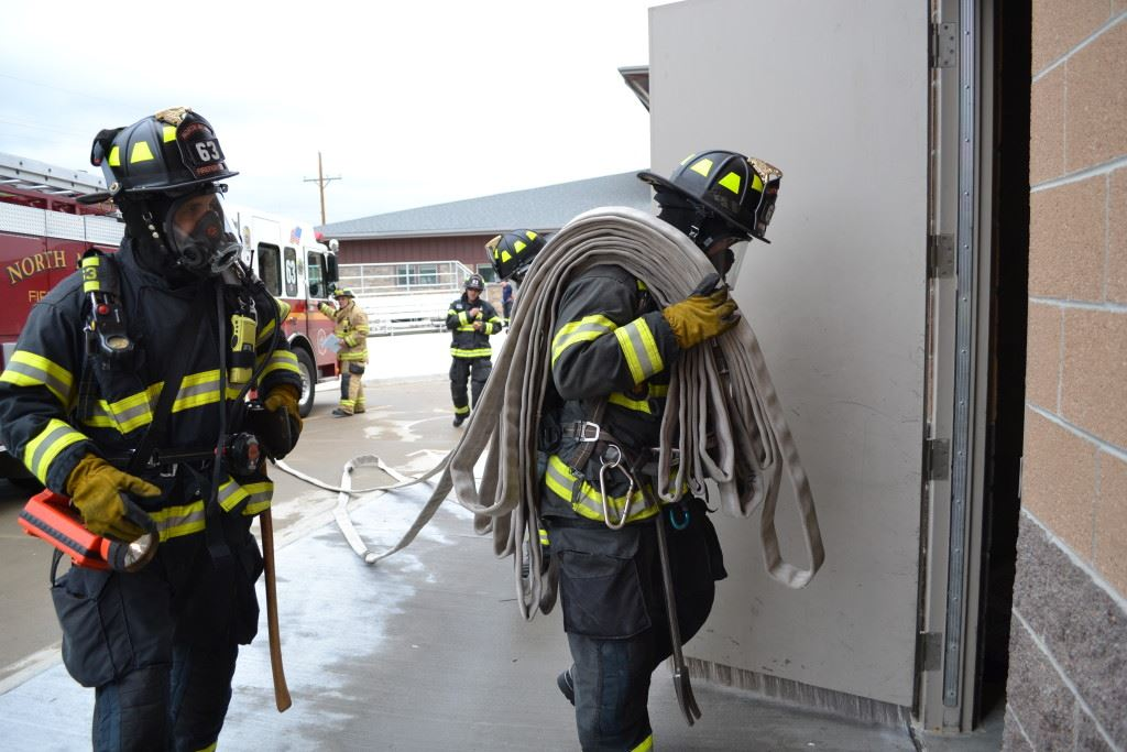 Fire Fighter in Gear with Fire Hose