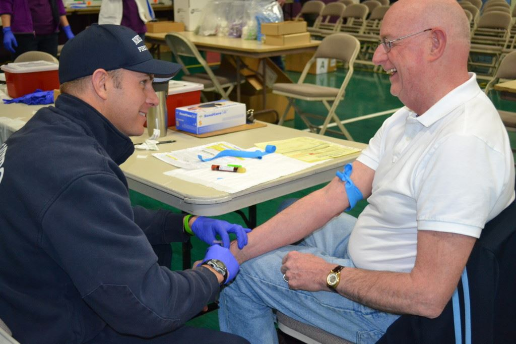 Man Drawing Another Man's Blood