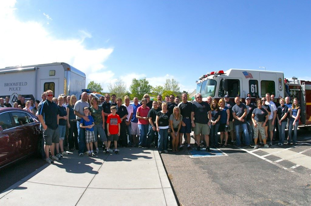 Group of People Standing in Front of Fire Trucks