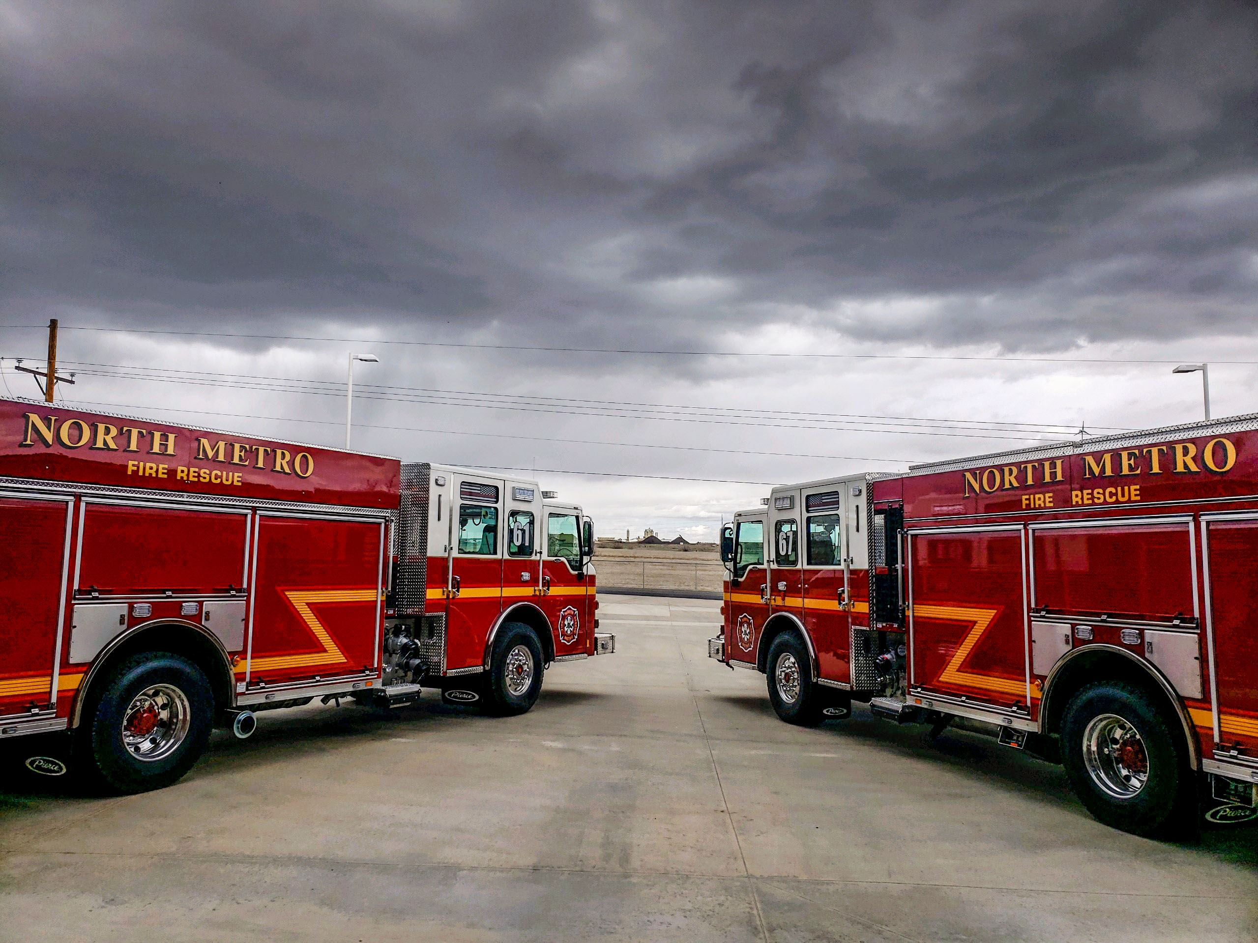 Photo of two new red fire engines being put into service at North Metro Fire