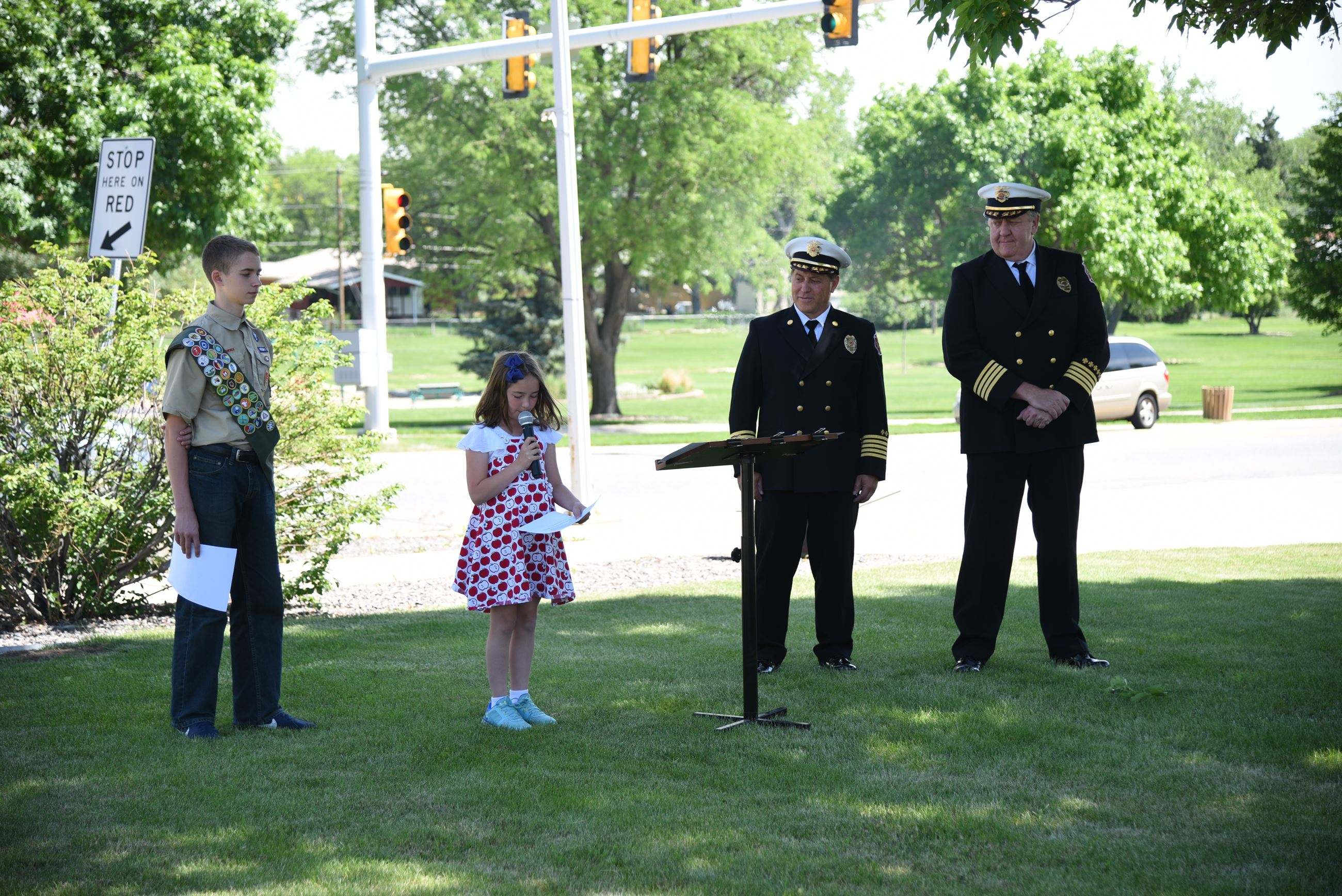 Two winners of the Flag Retirement Ceremony essay contest read their essays before the crowd at the