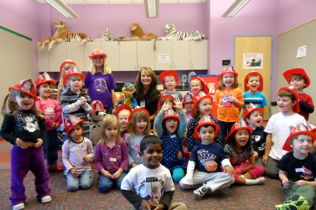 Kids in Classroom with Kid Fire Fighter Helmets on
